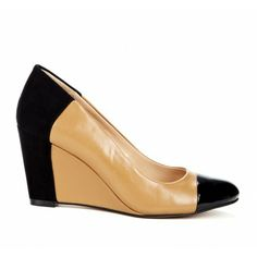 Round toe wedge with colorblock and mixed material detail.