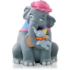 "Dumbo and his mom are the basis of this cute ornament.  And it plays ""Baby Mine,"" too."
