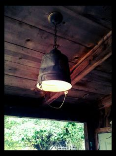 Old light on our porch needed to be replaced, so i did. with a pail!  great lighting for cabin