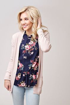 With a darker sweater could quickly look more fall. Love the print and style of the top. #casualworkoutfit