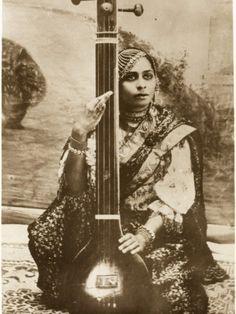 Lady playing tanpura