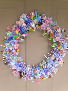 Interesting...a wreath made out of candy. This may be cute for a birthday party.