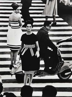 by William Klein from Roma (published in 1958). He worked with Fellini during this period.  (description provided by the awesome @lizarewind! :)
