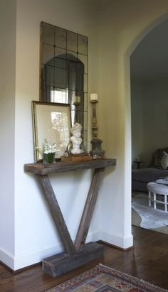 Good idea for narrow space, entryway, small foyer.