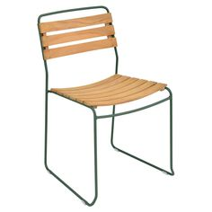 Fermob The Surprising Stacking Teak Patio Dining Chair blends the best of two elements – teak and steel. The trendy mixed material chair is treated for outdoors, but can also be used inside to create a sleek dining or lounge area.
