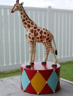 beautiful giraffe cake topper for a circus themed party. pair it with the elephant, lion and zebra cake toppers in this girl's shop by placing down the center of a table as a centerpiece or on top of saucers on candlesticks (if you didn't want to use it on a cake!). beautiful, beautiful. handmade and you can pick the color!