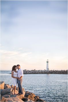 Nautical Oceanfront Harbor Lighthouse Engagement Session