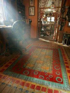Painted wood floor to look like a rug :)