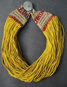 Link: http://ethnicjewels.ning.com/photo/naga-jewellery-10#!/photo/naga-jewellery-11?context=user. Very nice neckpiece with great yellow beads from Nagaland, India.