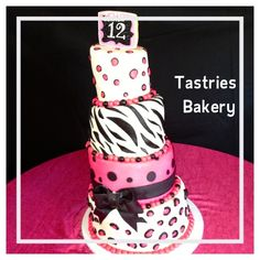 Pink, black and white fun and girly birthday cake with a big black bow from @Tastries Bakery