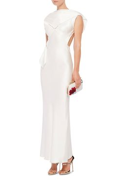 This silk charmeuse **Zac Posen** dress features a draped neck with an exposed back, tonal panels at the bodice, and a floor length bias cut column skirt.