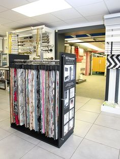 Replacing your window coverings? Call Elite Blinds & Curtains for a free home consultation. Phone 028 90 826900 or visit our blinds showroom in Lisburn Showroom Interior Design, Showroom Ideas, Curtain Designs For Bedroom, Curtain Shop, Retail Fixtures, Fabric Display, Shop Fittings, Retail Store Design, Shop Interiors