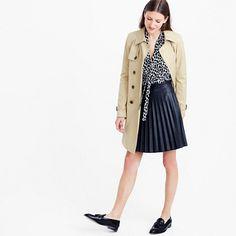 """With accordion pleats and a flattering mini length, our faux-leather skirt looks and feels just like the real thing. <ul><li>Sits at waist.</li><li>18"""" long.</li><li>Falls above knee.</li><li>Poly.</li><li>Back zip.</li><li>Dry clean.</li><li>Import.</li></ul>"""