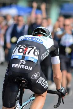 Julien Vermote rides to his celebrating Omega Pharma staff Photo credit © Rob Lampard