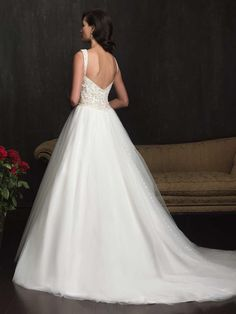 Allure Bridals style 9061 Available at Harts Tux's and Gowns,contact for your personal bridal experience and find your perfect wedding dress today http://www.hartstuxandgowns.com/