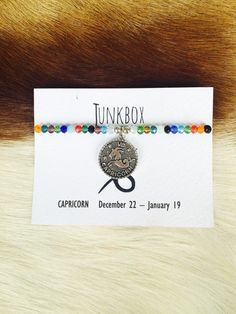 Capricorn zodiac beaded charm bracelet by JunkboxCouture on Etsy