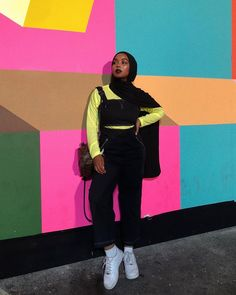 Image may contain: 1 person, standing Modest Fashion Hijab, Modern Hijab Fashion, Street Hijab Fashion, Hijab Fashion Inspiration, Muslim Fashion, Stylish Hijab, Fashion Trends, Neon Outfits, Edgy Outfits