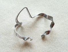 Silver aluminum sculptural ribbon bracelet, edgy jewelry, minimalist bracelet, modern, statement piece by MarkingTime on Etsy