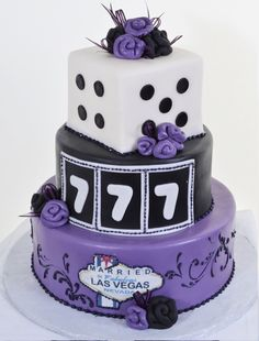 Pastry Palace Las Vegas - Wedding Cake #592 - Las Vegas Luck.  Triple tier white, black and lavender cake with die, lucky 7 slots & roses.