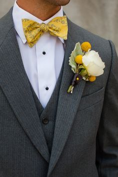 Yellow and white boutonniere: Rose, billy ball, and dusty miller #weddingboutonniere