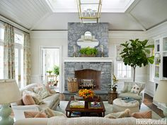 Little jolts of orange punctuate the beiges and pale blues in the family room of a Greenwich, Connecticut, house designed by Ashley Whittaker.   - HouseBeautiful.com