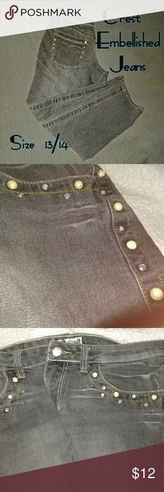 Crest Embellished Jeans Rhinestones and Faux pearls adorn these jeans that are in excellent shape! Jeans