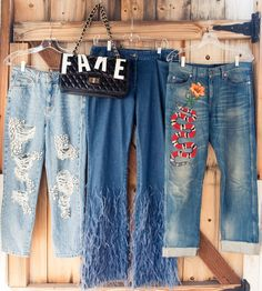 Inside the closet of Zerina Akers, Beyoncé's personal stylist, whose own wardrobe we would kill for. -- Topshop beaded ripped jeans, Michael Kors flared fringed jeans,  Gucci capris with snake print and Sonique Saturday fake purse.  | Coveteur.com