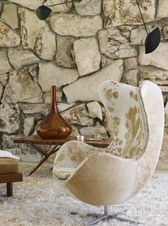 This amazing contrast of a round, soft egg chair with the jagged, harsh background of the stone wall. But they do have one thing in common, the color scheme. I even have a hard time in separating these two completely different elements from each other as I look at the picture.