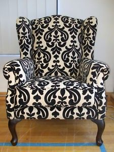 poltrona de tecido... Like this as a introduction of black into a room.