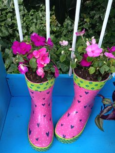 Purchased rain boots. Drilled holes in bottoms for drainage. Added some pea gravel to keep boots upright. Added potting soil and plants. (PIC ONLY-NO LINK).