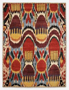 ikat area rug - yellow, brown, burnt orange, baby blue