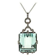 1940's aquamarine diamond platinum pendant.