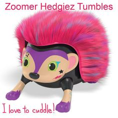 Zoomer tumbles is pink and purple with a black nose and a stars and a
