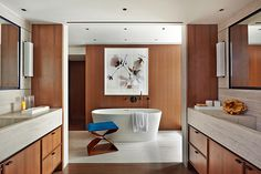 For this Park Avenue apartment, the owner — a well-known cosmetics mogul — tasked Groves & Co. with creating a spa-like bathroom suite. The firm used heavily grained travertine countertops and glossy walnut paneling to create a space that is both serene and sophisticated. The hand-carved wooden stool is by Carol Egan and was sourced at Maison Gerard