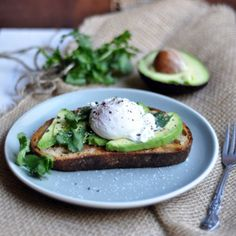 Avocado with poached eggs via Turntable Kitchen