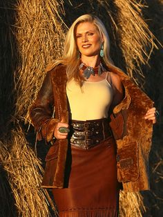 Front view of Brit West's beautiful Mountain Girl Jacket, with shearling lining and collar.  Optional leather inside pocket allows for a concealed weapon (small gun, of course). ~