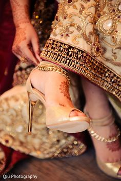 This beautiful Pakistani bride gets all dolled up for her muslim wedding ceremony with lovely shoes.