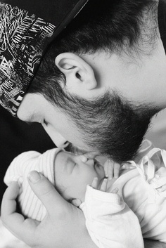 Daddy's first kiss.