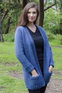 Free knitting pattern. Pattern category: Cardigans. Bulky weight yarn. 1200-1500 yards. Features: In-the-round, Pocket, Top-Down. Intermediate difficulty level.