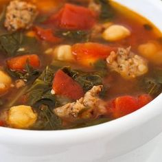 Sausage and Red Russian Kale Soup with Tomatoes, Chickpeas, and Herbs Recipe Soups with onions, olive oil, fresh rosemary, chopped fresh sage, minced garlic, tuscan sausage, chicken stock, tomatoes with juice, tomato sauce, Vegeta Seasoning, ground black pepper, red russian kale, chickpeas, freshly grated parmesan