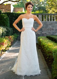 Lea-Ann Butler, Greydon Hall, Roberta. Crafted from airy silk organza and French Alencon lace, Roberta is a celebration of old world romance and modern style. This gown's sleek, fluted silhouette is finished with a hand-beaded organza belt, delicately scalloped hem, and demure sweep train.