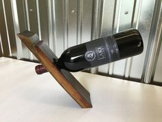 Stix+Steel oak stave floating wine bottle holders are the perfect gift for Holidays, weddings, showers, anniversary celebrations and your own home! This floating wine bottle holder was hand crafted using authentic, reclaimed oak wine or bourbon barrels from Ohio wineries and breweries and holds one bottle of wine.  This piece was individually cut by hand giving it a unique, one of a kind appearance where no two are exactly alike. The product shape, grain variation and color differences give…