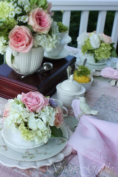 QUILT AND ROSES TEA ON THE PORCH  ~I have always loved a quilt on a table.  It adds just that perfect touch!
