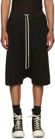 Relaxed-fit cotton fleece sarouel-style shorts in black. Drawstring in beige at elasticized poplin waistband. Four-pocket styling. Button-fly. Gunmetal-tone hardware. Tonal stitching.