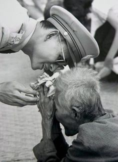 Thai King Bhumibol Adulyadej greets one of his loyal subjects in the central region of Thailand