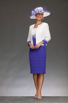 Knee length fitted shift dress with wide neck and slight capped sleeves. The skirt of the dress is layered chiffon giving a very flattering silhouette. There is embroidery at the waist softening the caontrast between the bust and the skirt. The jacket is collarless and has embroidered cuffs. Product Code: 29170 Colour: Cream/Majestic Purple
