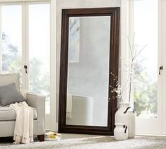 Add visual depth to your living room or bedroom with the Banks Mirror. The wooden frame makes a big impact in modern spaces and farmhouse aesthetics alike. Living Room Mirrors, Living Room Furniture, Dining Rooms, Extra Wide Dresser, Tall Dresser, Dentil Moulding, Small Entryways, Wall Candle Holders, Shelves In Bedroom