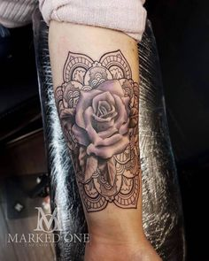 Feminine colour Rose tattoo. Purple rose tattoo with Mandala style background.
