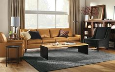 Living - Room & Board  Like the gold color leather with the black and grey