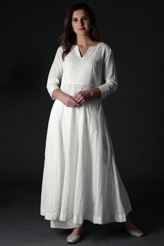 Ethereal White Chikankari Hand embroidered cotton Anarkali kurta with Chikankari floral and paisley embroidery on front bodice and and sleeves paired with Chikankari hand embroidered palazzo pants. Indian Fashion Dresses, Indian Designer Outfits, Indian Outfits, Designer Dresses, Indian Gowns, Salwar Designs, Kurta Designs Women, Kurti Designs Party Wear, White Anarkali